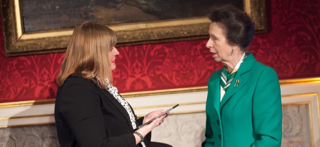 HRH The Princess Royal presenting an Award to Liz Willis, Head of Learning & Development, Caring Homes Group